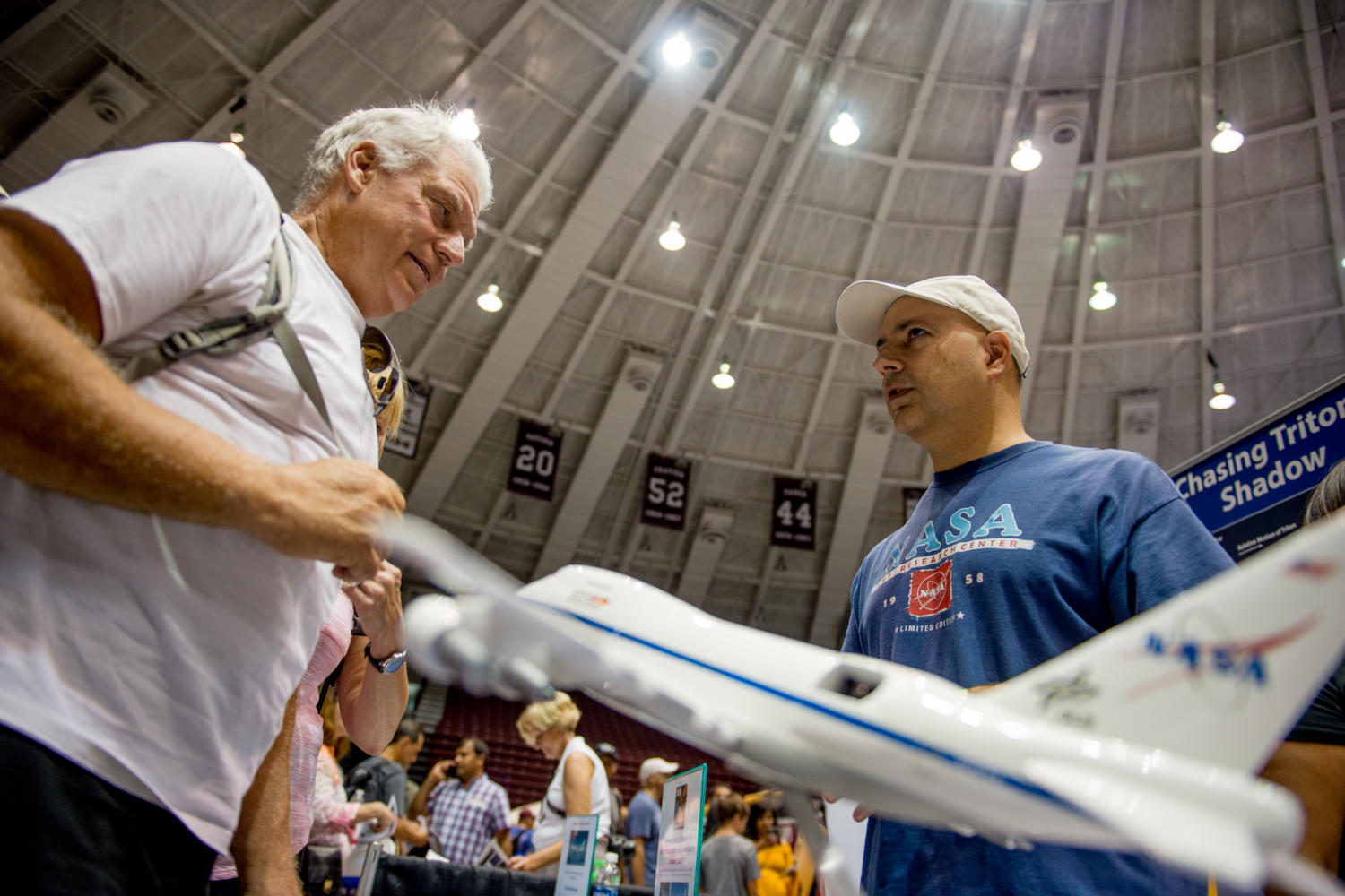 Universities Space Research Association software developed Scott Davis, of Mountain View, California, explains the components of the Stratospheric Observatory for Infared Astronomy (SOFIA) project to John Cremma, of Chicago Monday, Aug. 21, 2017, at the science astronomy and technology expo, at the SIU Arena. (Brian Muñoz | @BrianMMunoz)