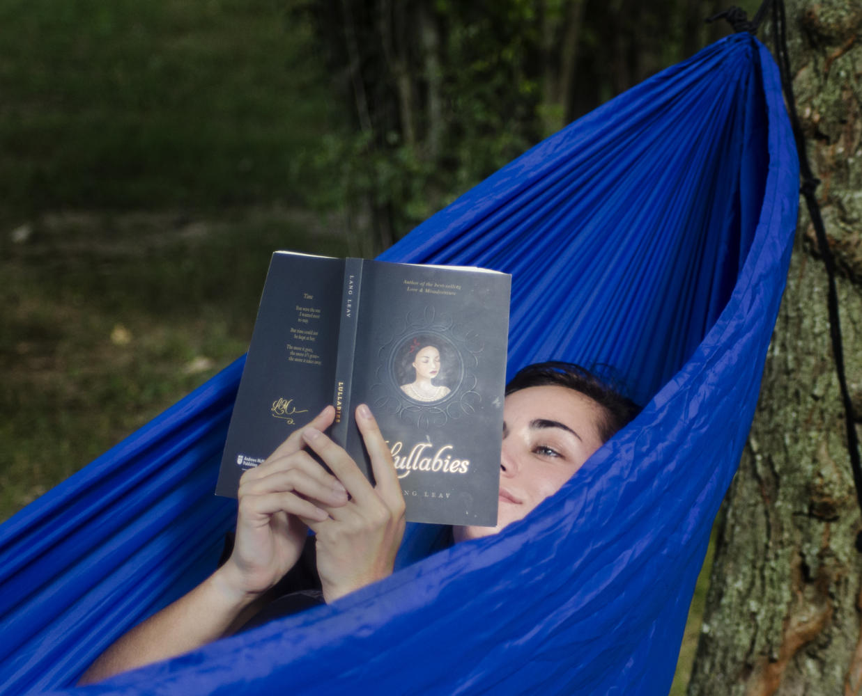 Taylor Goldtrap, a junior from Kankakee majoring in forestry, read a poetry book while relaxing in a hammock Tuesday, Aug. 22, 2017, at Thompson Point.