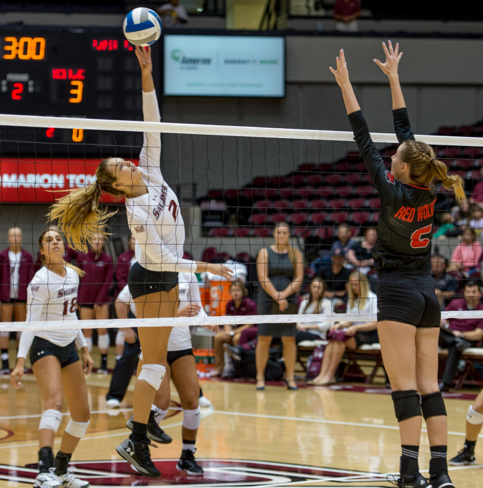 Freshman opposite hitter Maggie Nedoma, 2, strikes the ball Tuesday, Aug. 29, 2017, during the Salukis'  3-1 loss to Arkansas State University at SIU Arena. (Dylan Nelson | @DylanNelson99)