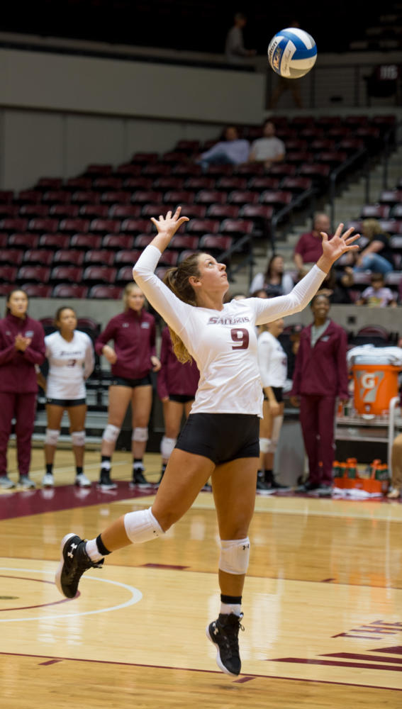Redshirt senior outside hitter Andrea Estrada jumps for a serve Tuesday, Aug. 29, 2017, during the Salukis' 22-25 loss to Arkansas State University at SIU Arena. (Dylan Nelson | @DylanNelson99)