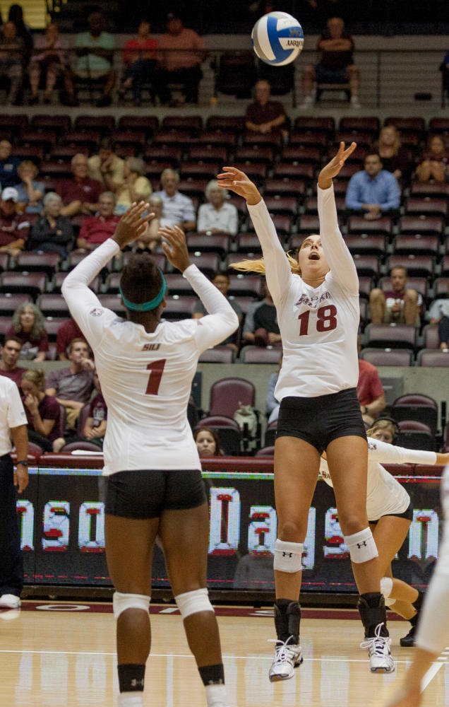 Sophomore setter Alayna Martin, 18, passes ball to Senior middle hitter Kolby Meeks, 1, Tuesday, Aug. 29, 2017, during the Saluki Women's Volleyball home opener at SIU Arena. The Salukis fell to Arkansas State University in the final set, 22-25. (Mary Newman | @MaryNewmanDE)
