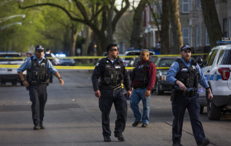 Members of the Chicago Police Department investigate the area where two people were shot in the 6400 block of South Eberhart Avenue on April 24, 2017, in Chicago, Ill. (Armando L. Sanchez/Chicago Tribune/TNS)