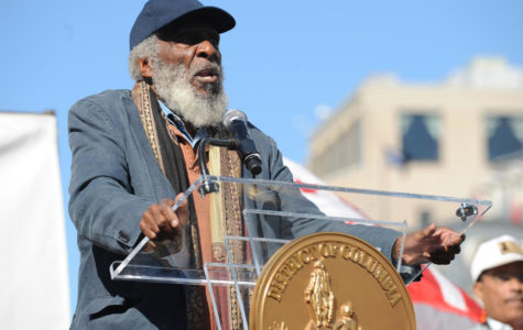 Dick Gregory speaks at the D.C. Full Democracy Freedom Rally and March in Washington, D.C., on October 15, 2011. Gregory, a comedian, activist and author, died on Saturday, Aug. 19, 2017.