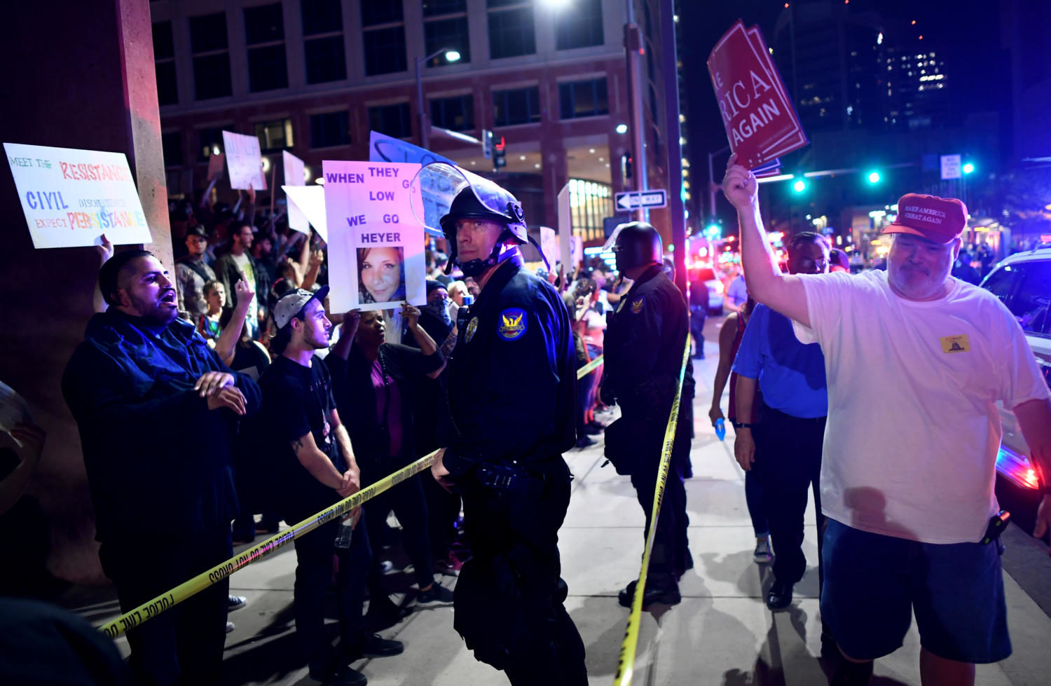 Trump+protestors%2C+left%2C+yell+as+a+Trump+supporter+leaves+the+convention+center+where+President+Donald+Trump+spoke+in+Phoenix+on+Tuesday%2C+Aug+22%2C+2017.+%28Wally+Skalij%2FLos+Angeles+Times%2FTNS%29