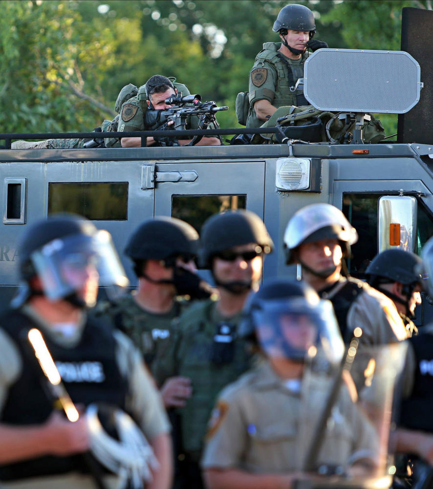 A police sharpshooter keeps an eye on protesters along W. Florissant Avenue on Tuesday, Aug. 12, 2014, in Ferguson, Mo. (David Carson/St. Louis Post-Dispatch/TNS)