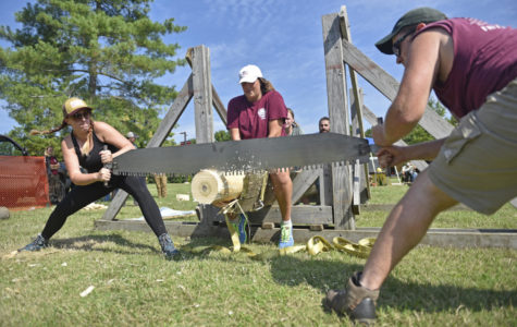 SIU Forestry Club puts timber sports on display during campus eclipse festivities