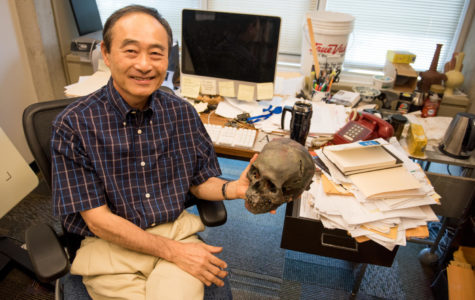 Professor of Anthropology Izumi Shimada, of Carbondale, flashes a smile for a portrait Monday, Aug. 28, 2017, at his office in Faner Hall. Shimada has been studying the Peruvian subculture, which he named the