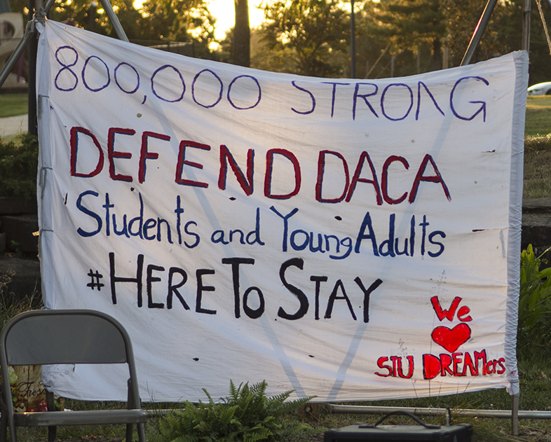 A poster hangs outside the pavilion at Gaia House on Tuesday, Sept. 5, 2017, during a vigil held for DACA students. (Athena Chrysanthou | @Chrysant1Athena)