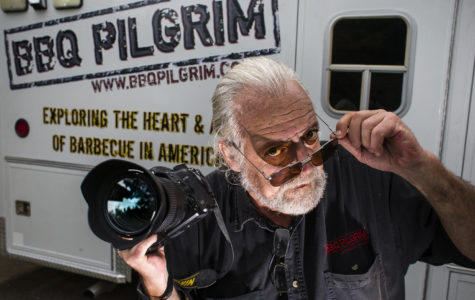 SIU photojournalism professor Mark Dolan poses for a portrait Thursday, Aug. 31, 2017, outside his barbecue Pilgrim ambulance. (Athena Chrysanthou | @Chrysant1Athena)
