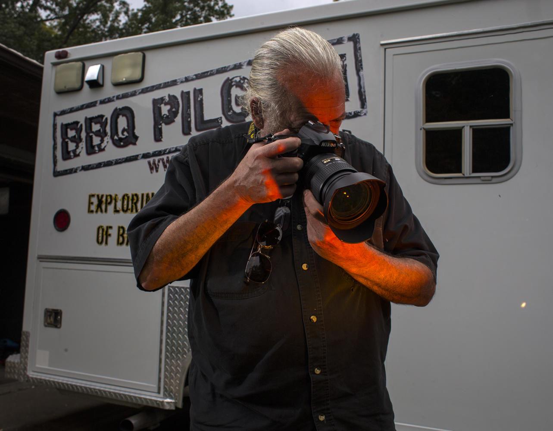SIU photojournalism professor Mark Dolan poses for a portrait Thursday, Aug. 31, 2017, outside his barbecue Pilgrim ambulance. (Athena Chrysanthou | @Chrysant1Athena)