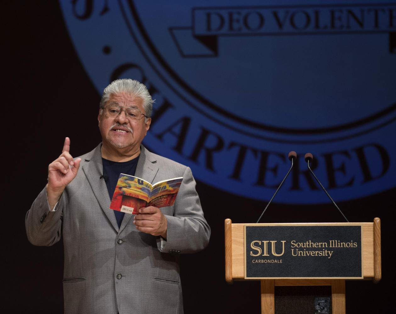 "Poet lauterate Luis Rodriguez reads from his book ""Borrowed Bones: New Poems from the Poet Laureate of Los Angeles"" Tuesday, Sept. 26, 2017 during a presentation in part of the Nancy and Micheal Glassman lecture series in the SIU Student Center. (Dylan Nelson 