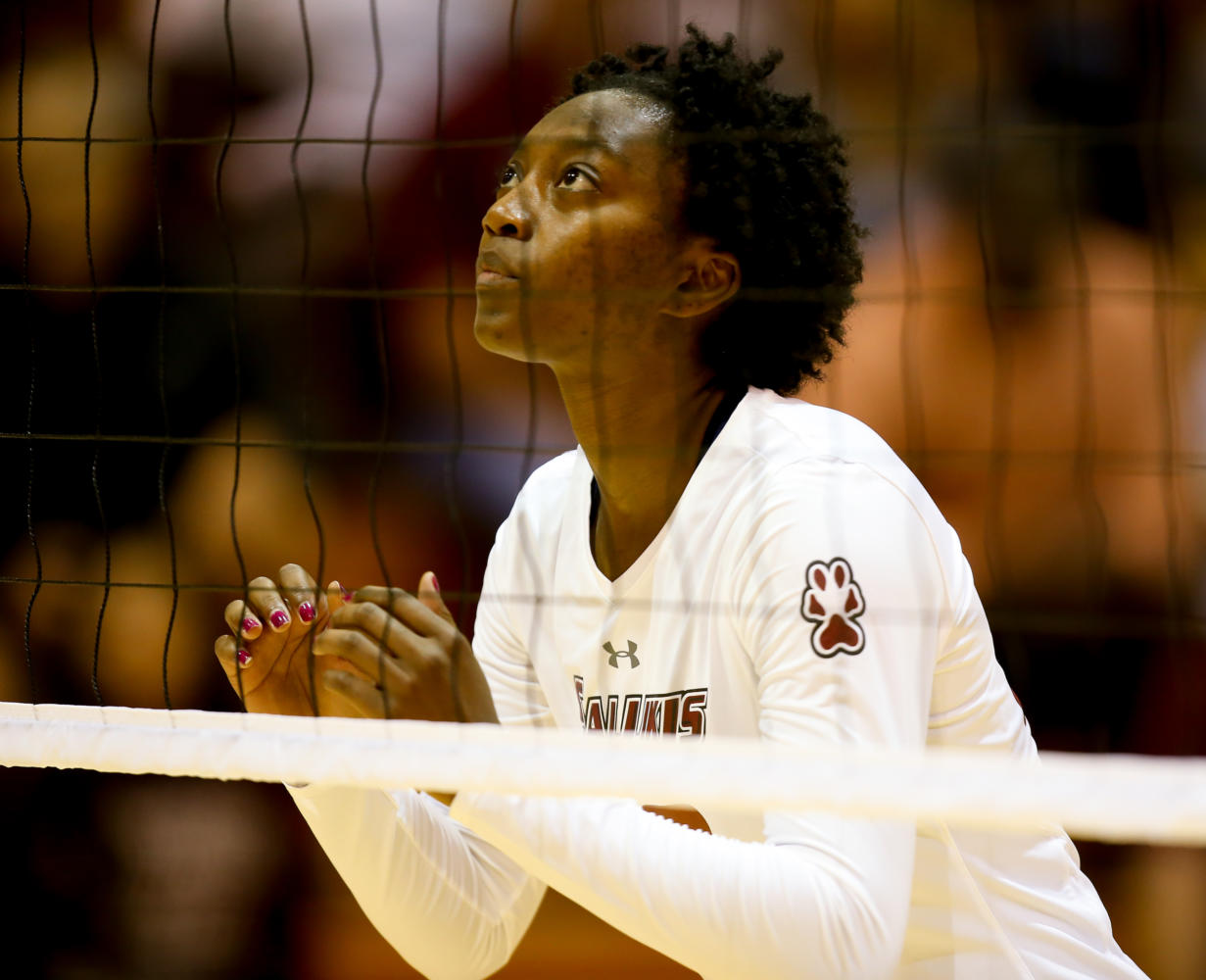 Middle blocker Patience Brown eyes the ball during the Saluki's winning game against the Evansville Purple Aces Sept. 29, 2017, at Davies Gym.