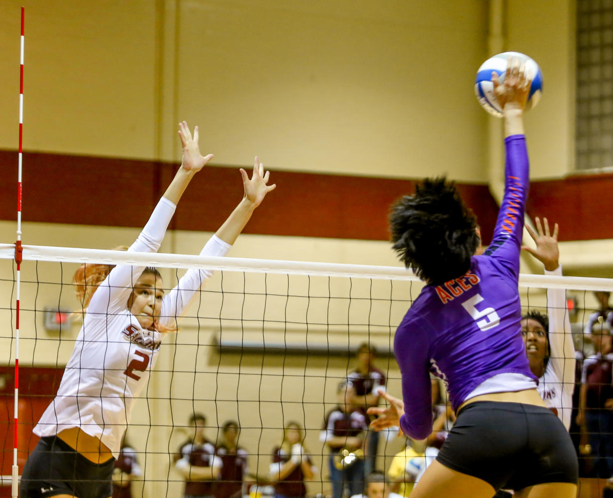 Evansville sophomore defensive hitter Rachel Tam returns the ball during the Saluki's winning game against the Evansville Purple Aces Friday, Sept. 29, 2017, at Davies Gym in Carbondale. (Brian Muñoz | @BrianMMunoz)