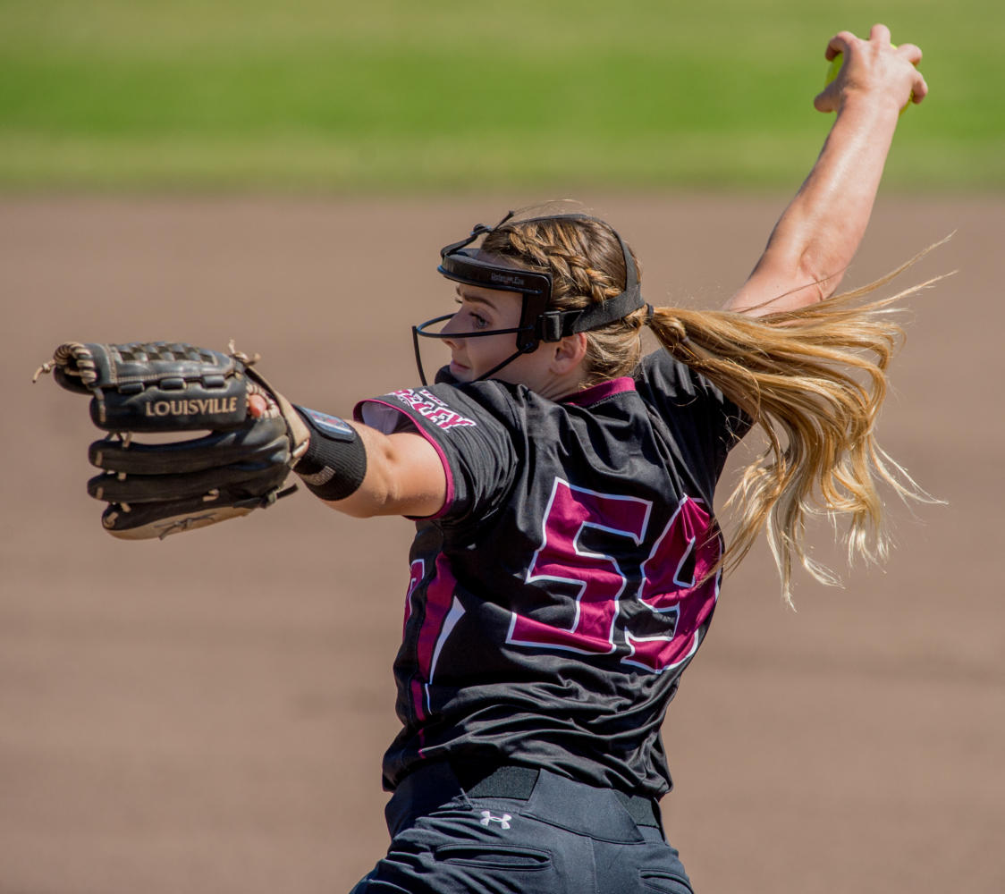 Senior pitcher Savannah Dover winds up a ball Sunday, Sept. 10, 2017, during the Salukis' home opener against Rend Lake College at Brechtelsbauer Field. The Saluki Softball team returns to SIU after winning the 2017 Missouri Valley Conference championship. (Brian Muñoz | @BrianMMunoz)