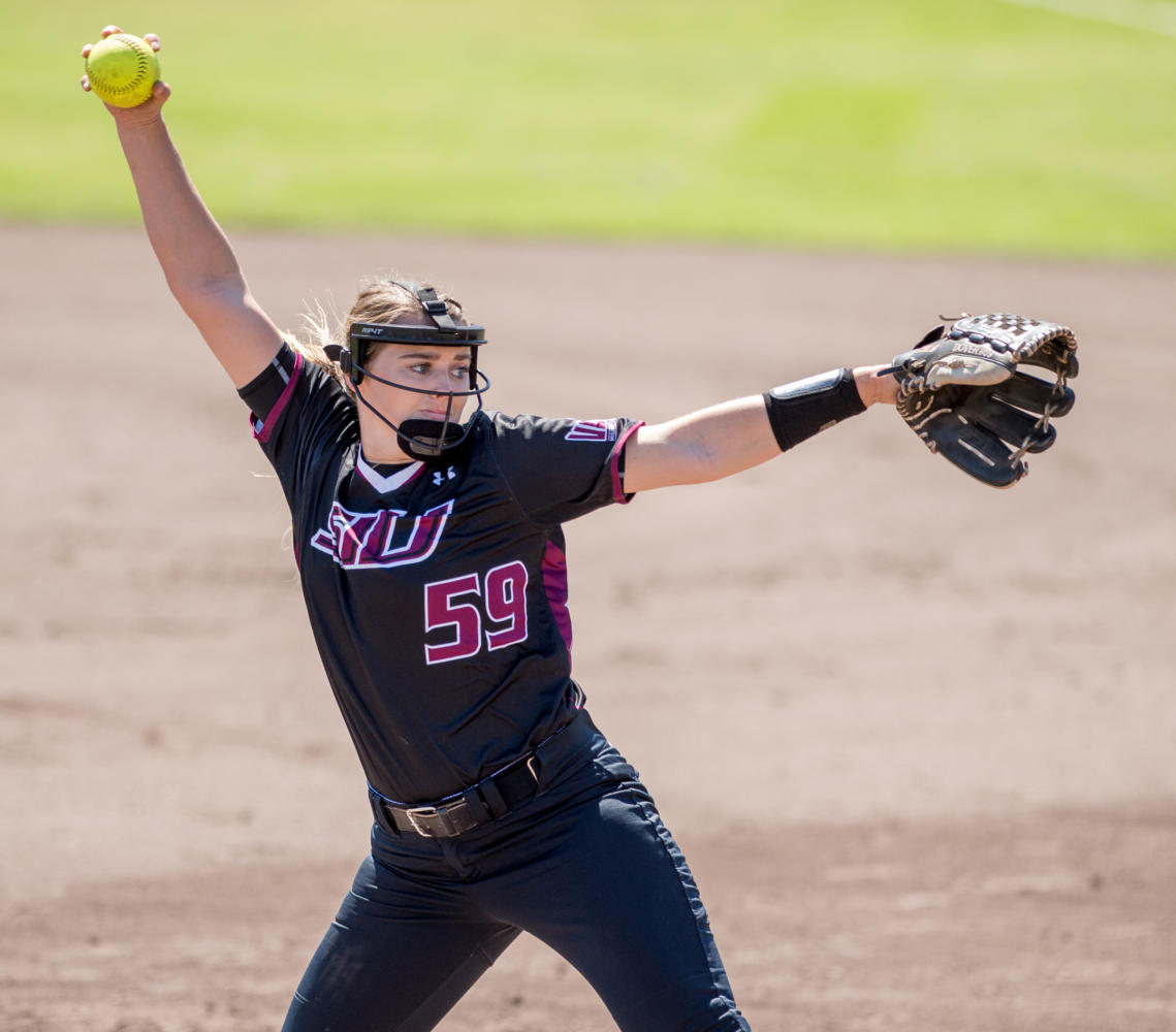 Senior pitcher Savannah Dover winds up a ball Sunday, Sept. 10, 2017, during the Saluki's home opener against Rend Lake College. The Saluki Softball team returns to SIU after winning the 2017 Missouri Valley Conference championship. (Brian Muñoz   @BrianMMunoz)