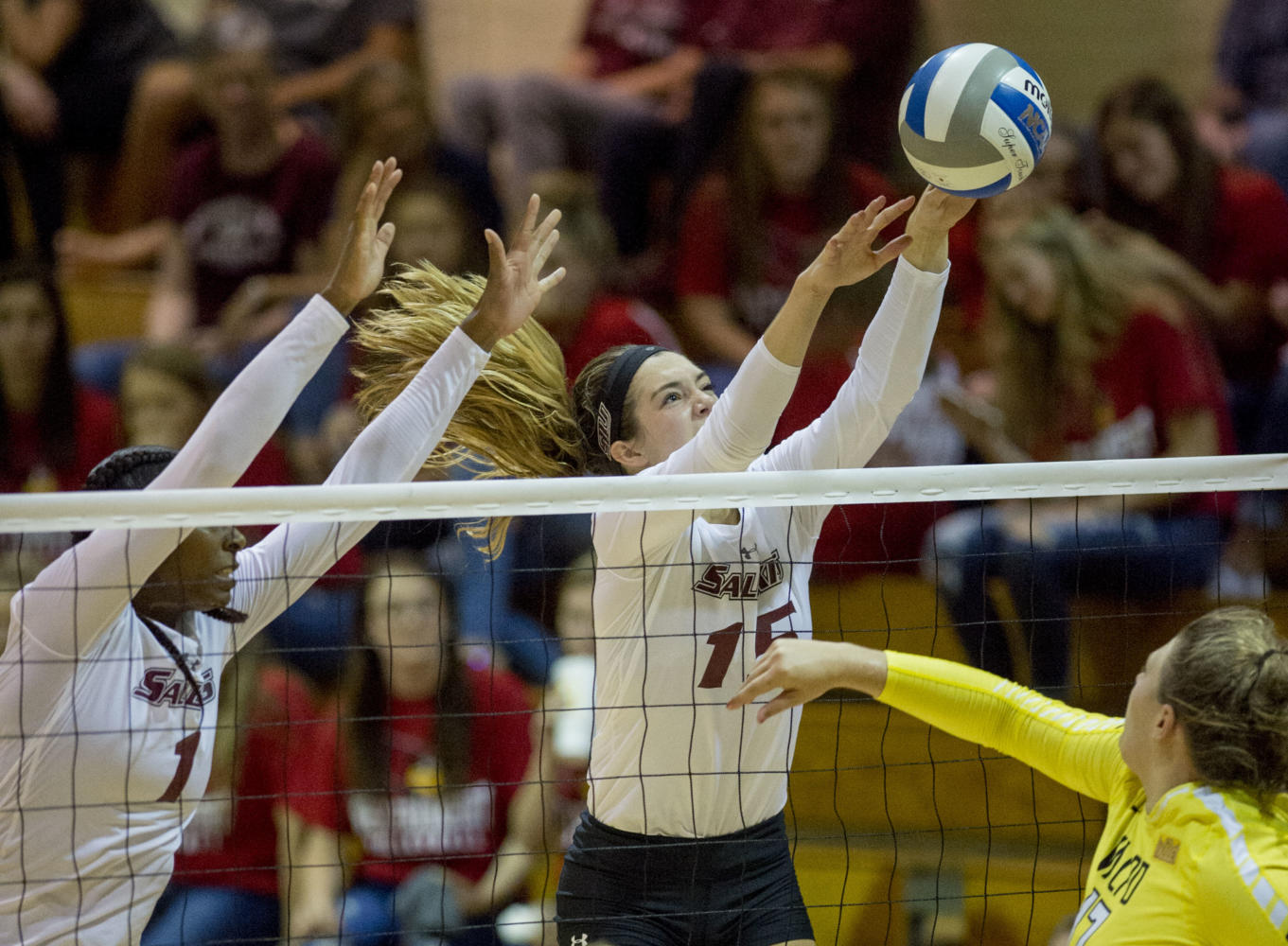 Senior middle hitter Kolby Meeks (left) and senior outside hitter Abby Barrow (right) block the ball Monday, Sept. 25, 2017, during the Salukis' 2-1 win against Valparaiso University at Davies Gym. (Dylan Nelson | @Dylan_Nelson99)