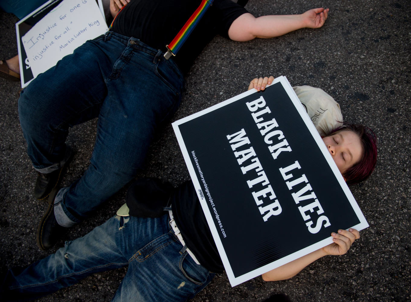 Protesters stage a die-in on the corner of Delmar and Skinker on Saturday, Sept. 16, 2017, in St. Louis, Missouri. The protests come a day after former St. Louis police officer Jason Stockley was found not guilty in the fatal shooting of Anthony Lamar Smith.  (Brian Muñoz | @BrianMMunoz)