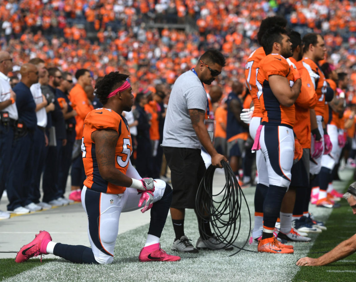 Denver Broncos' Brandon Marshall kneels during the national anthem before a game against the Atlanta Falcons on Sunday, Oct. 9, 2016 at Sports Authority Field at Mile High in Denver, Colo. (Mark Reis/Colorado Springs Gazette/TNS)