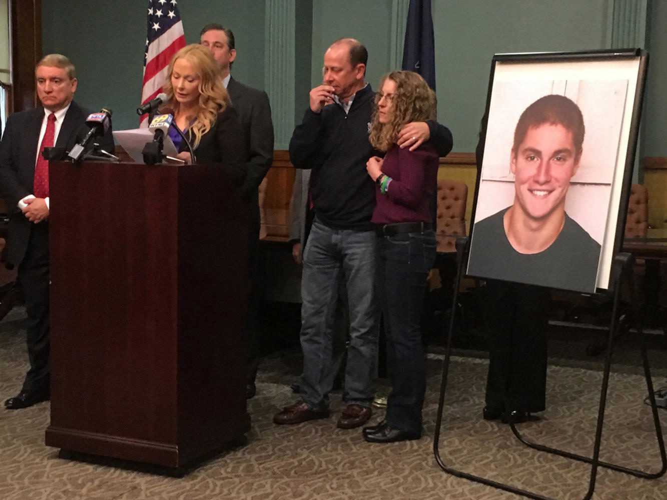 At podium is Stacy Parks, Miller Centre County District Attorney, with James and Evelyn Piazza, parents of Timothy Piazza, 19, of Readington Township, N.J. during a press conference at Bellefonte courthouse on Friday morning May 5, 2017.  (David Swanson/Philadelphia Inquirer/TNS)