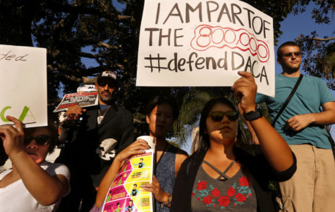 Los Angeles Harbor College student Brenda Soriano, second from right, and her mother Edilbertha Martinez, left, participate in a rally in support of the Deferred Action for Child Arrivals, or DACA program in Los Angeles on September 5, 2017. Brenda and her sister Diana Martinez are in the Deferred Action for Child Arrivals, or DACA program. The Soriano family are originally from Oaxaca, Mexico. Diana is studying to be an aerospace engineer and Brenda is studying to be a journalist. The girls came illegally to the U.S. at ages 3 and 7 in the back of a van through Tijuana. (Genaro Molina/Los Angeles Times/TNS)