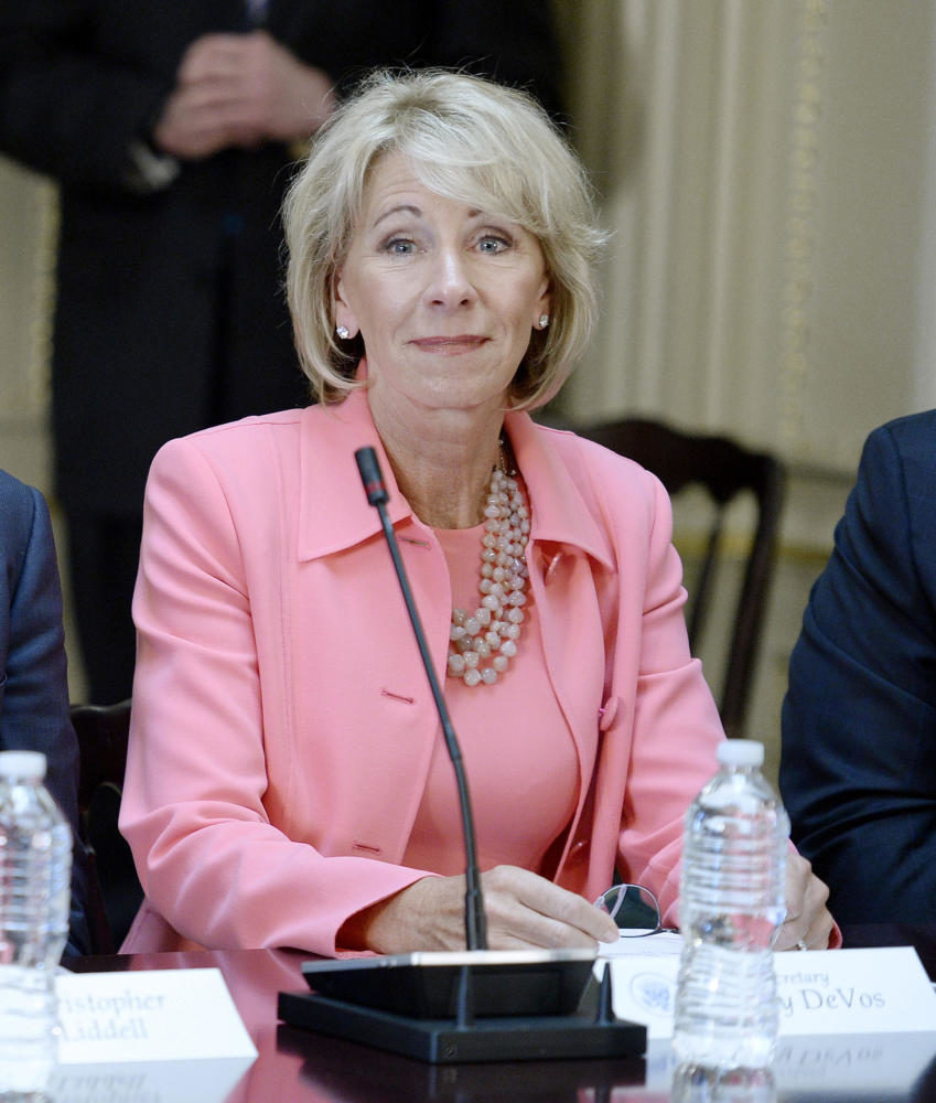 Education Sec. Betsy DeVos listens as U.S. President Donald Trump speaks during a strategic and policy discussion with CEOs in the State Department Library in the Eisenhower Executive Office Building on April 11, 2017, in Washington, D.C. (Olivier Douliery/Abaca Press/TNS)