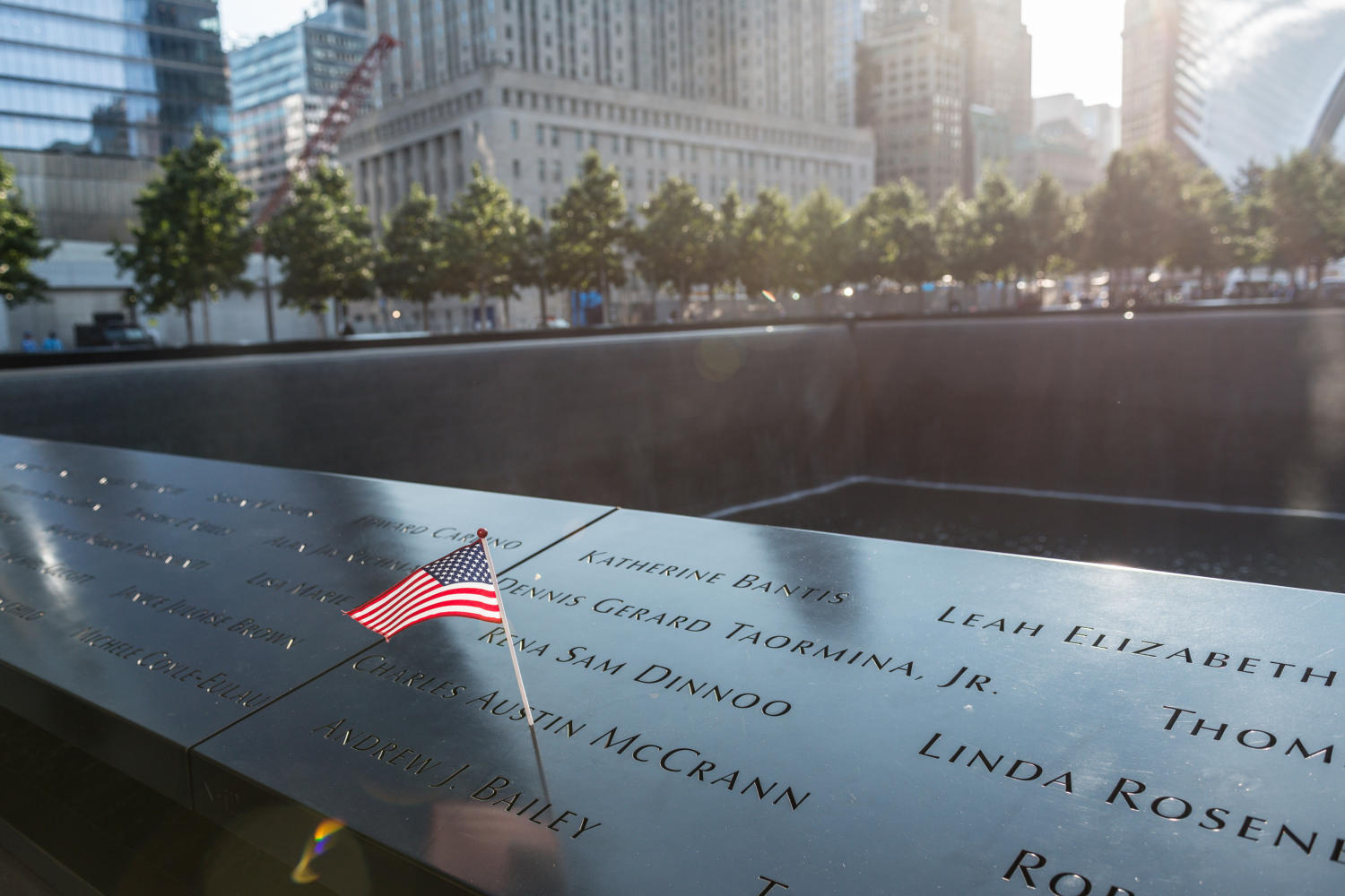 The name of a victim of the 9/11 attacks is seen adorned an American flag on the perimeter of a reflecting pool at a ceremony commemoratoing the 16th anniversary of the September 11th terrorist attacks at the World Trade Center site in New York, New York, NY, USA on September 11, 2017. (Albin Lohr-Jones/Sipa USA/TNS)