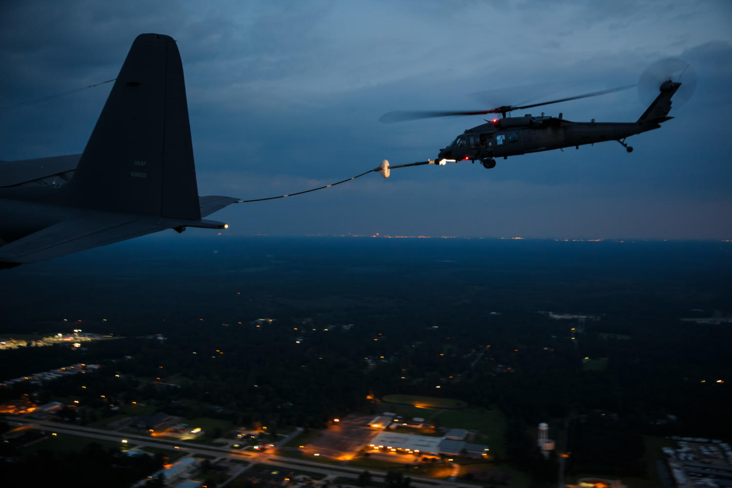 A military search and rescue helicopter is refueling mid-flight before resuming nighttime missions over areas flooded in the aftermath of Tropical Storm Harvey in Lumberton, Texas, on Thursday, Aug. 31, 2017. (Marcus Yam/Los Angeles Times/TNS)