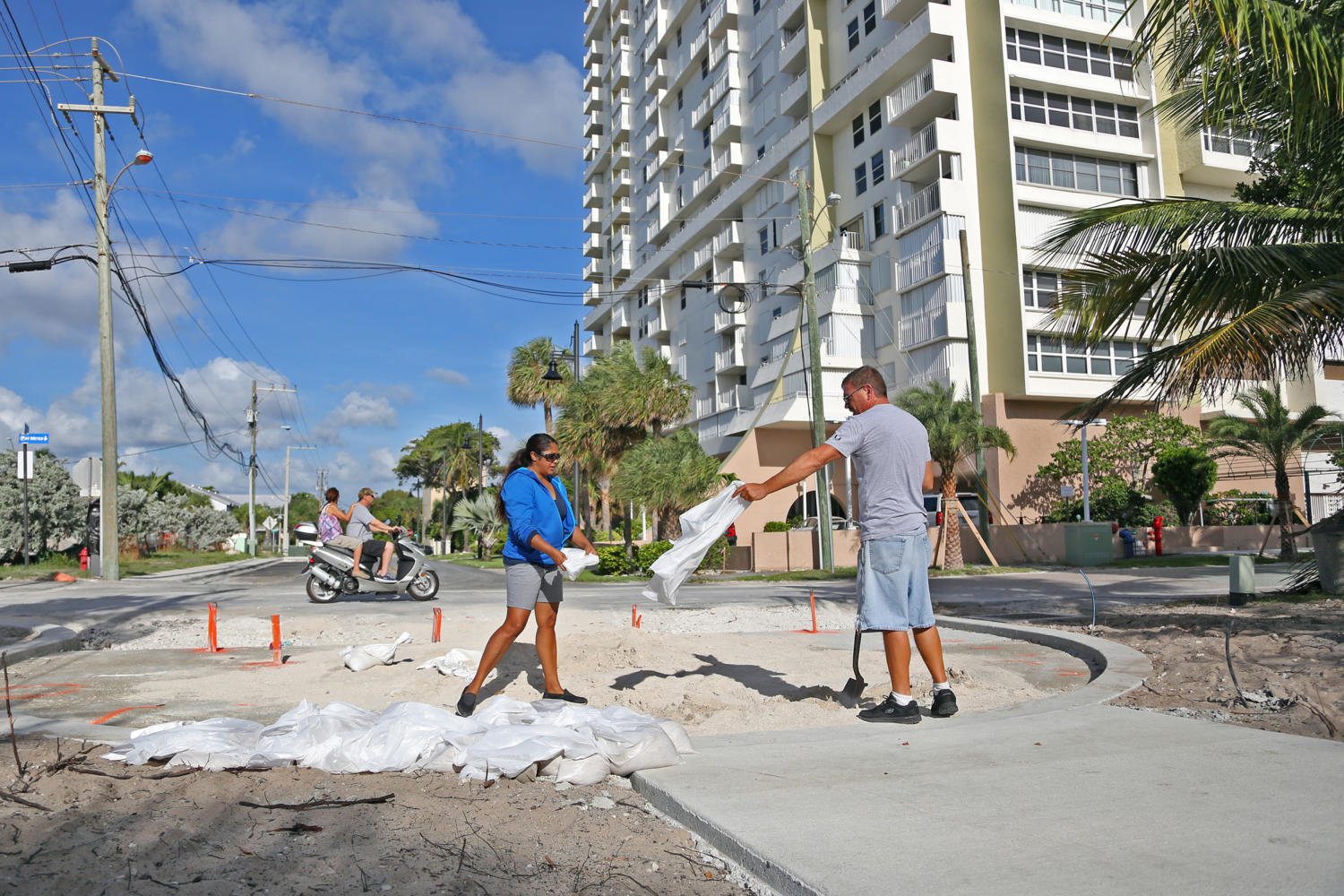 Liz Hankins and James Kiernan, of North Lauderdale, fill trash bags with sand on Pompano Beach in preparation for Hurricane Irma on Friday, Sept. 8, 2017. (Amy Beth Bennett /Sun Sentinel/TNS) SOUTH FLORIDA OUT; NO MAGS; NO SALES; NO INTERNET; NO TV
