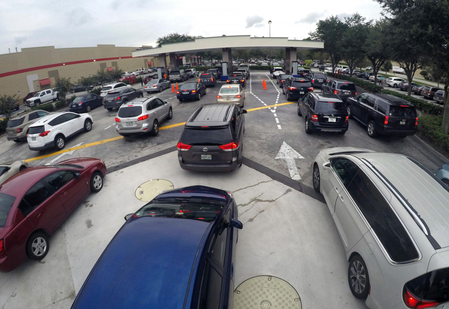 Drivers wait in line for gasoline at the Costco in Altamonte Springs, Fla., ahead of the anticipated arrival of Hurricane Irma on Wednesday, Sept. 6, 2017. (Joe Burbank/Orlando Sentinel/TNS)