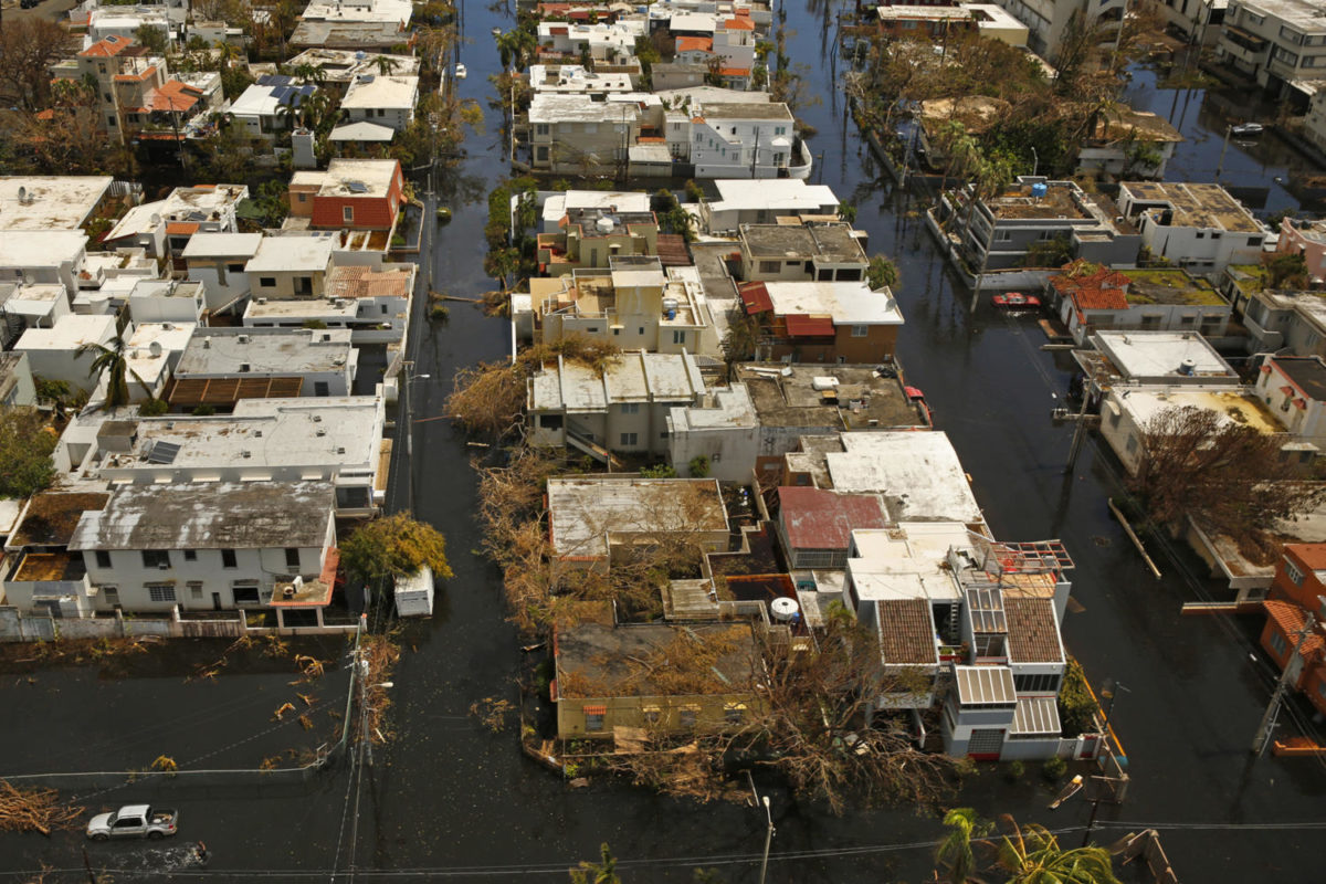 Nearly+one+week+after+hurricane+Maria+devastated+the+island+of+Puerto+Rico%2C+residents+are+still+trying+to+get+the+basics+of+food%2C+water%2C+gas+and+money+from+banks.+Much+of+the+damage+done+was+to+electrical+wires%2C+fallen+trees%2C+and+flattened+vegetation%2C+in+addition+to+wooden+home+roofs+torn+off.+%28Carolyn+Cole%2FLos+Angeles+Times%2FTNS%29
