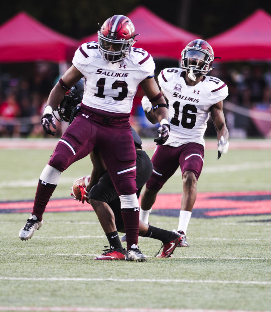 Senior inside linebacker Markese Jackson (left) and Sophomore safety James Ceasar celebrate a tackle Saturday, Sept. 16, 2017, during the SIU's second game of the season against Southeastern Missouri State. The Salukis topped the Redhawks, 35 - 17. (Dylan Nelson | @Dylan_Nelson99)