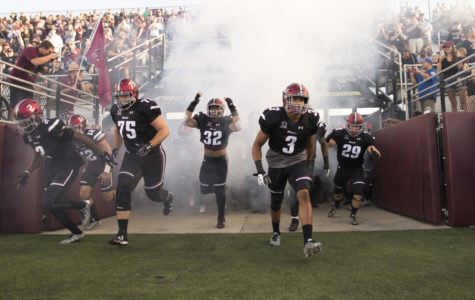 Salukis rush into the stadium Saturday, Sept. 30, 2017, before the match against the University of Northern Iowa at Saluki Stadium. (Dylan Nelson | @Dylan_Nelson99)