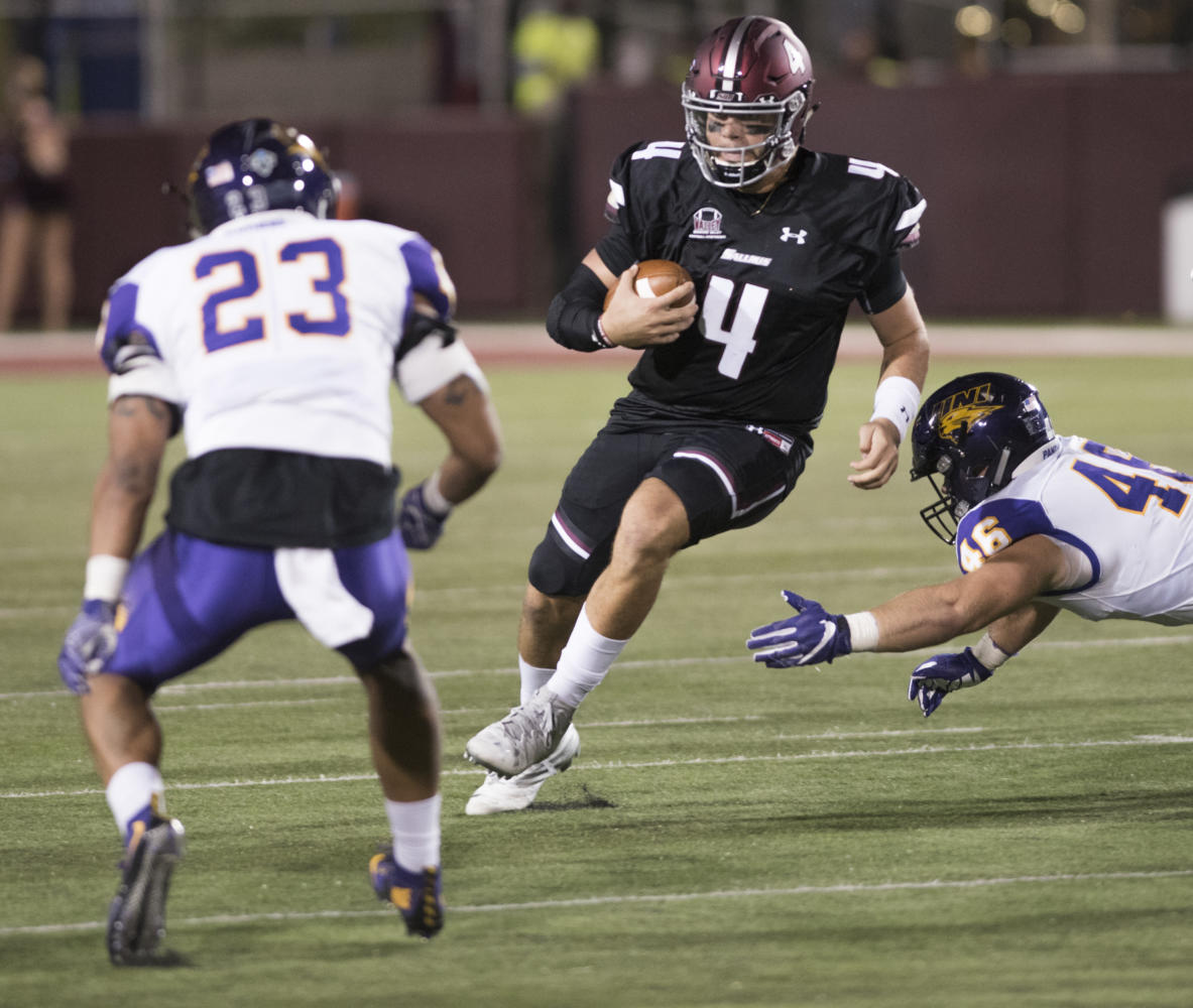 Junior quarterback Sam Straub rushes  Saturday, Sept. 30, 2017, during the Salukis' 24-17 loss to the University of Northern Iowa at Saluki Stadium. (Dylan Nelson | @Dylan_Nelson99)