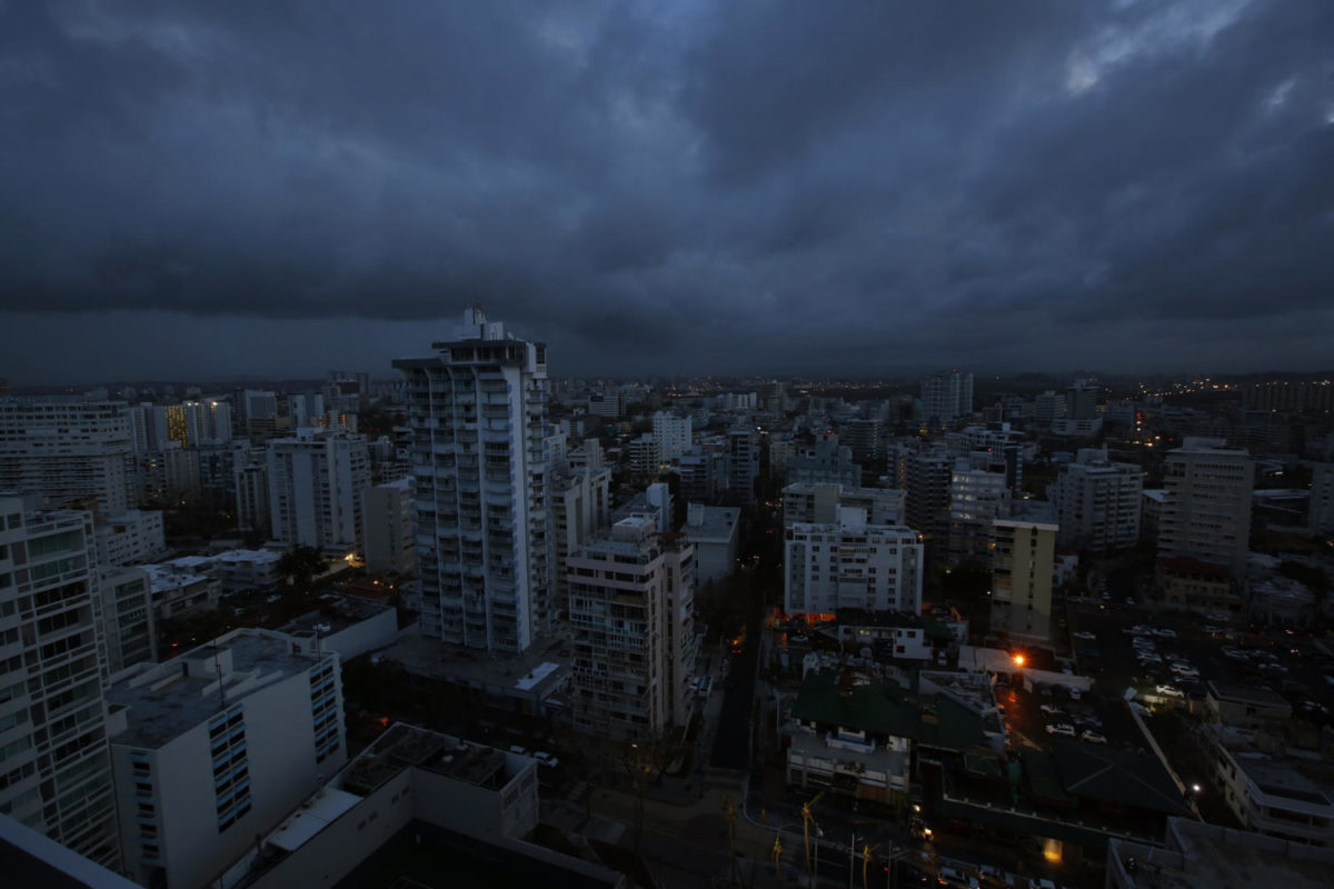 In downtown San Juan, Puerto Rico, some buildings have generator-driven lights, as there is no public electricity working anywhere on the island, on Thursday, Sept. 28, 2017. (Carolyn Cole/Los Angeles Times/TNS)