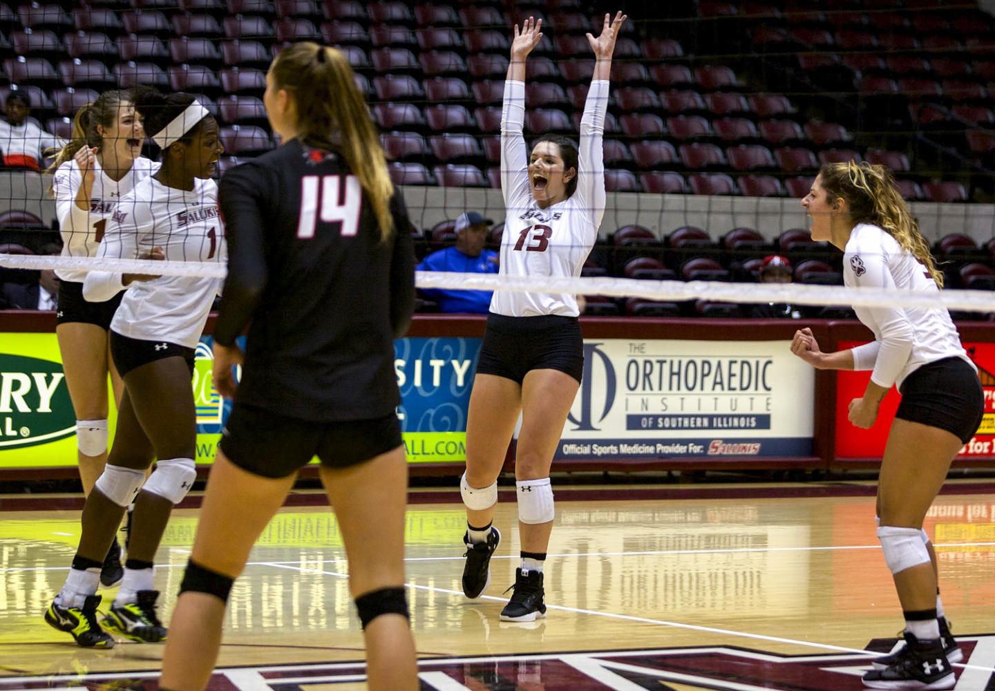 Freshman+setter+Rachel+Maguire%2C+13%2C+celebrates+with+her+teammates%2C+Tuesday%2C+Sept.+12%2C+2017%2C+during+the+Saluki%27s+home+game+at+SIU+Arena.+The+Salukis+beat+the+Redhawks+in+the+fifth+set%2C+15-13.+%28Mary+Newman+%7C+%40MaryNewmanDE%29
