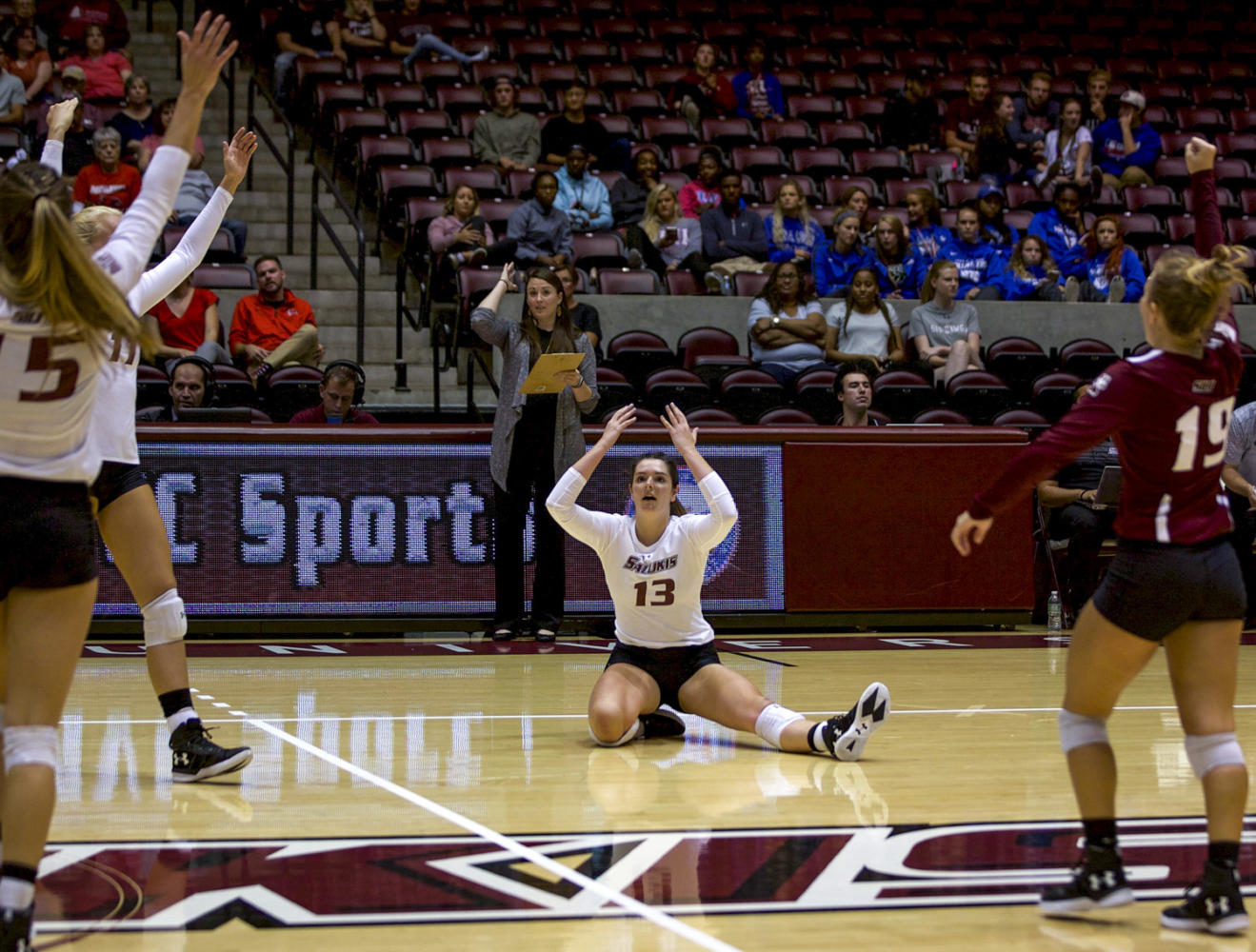 Freshman setter Rachel Maguire, 13, reacts in celebration with her teammates after scoring a point Tuesday, Sept. 12, 2017, during the Saluki's home game at SIU Arena. The Salukis beat the Redhawks in the fifth set, 15-13. (Mary Newman | @MaryNewmanDE)