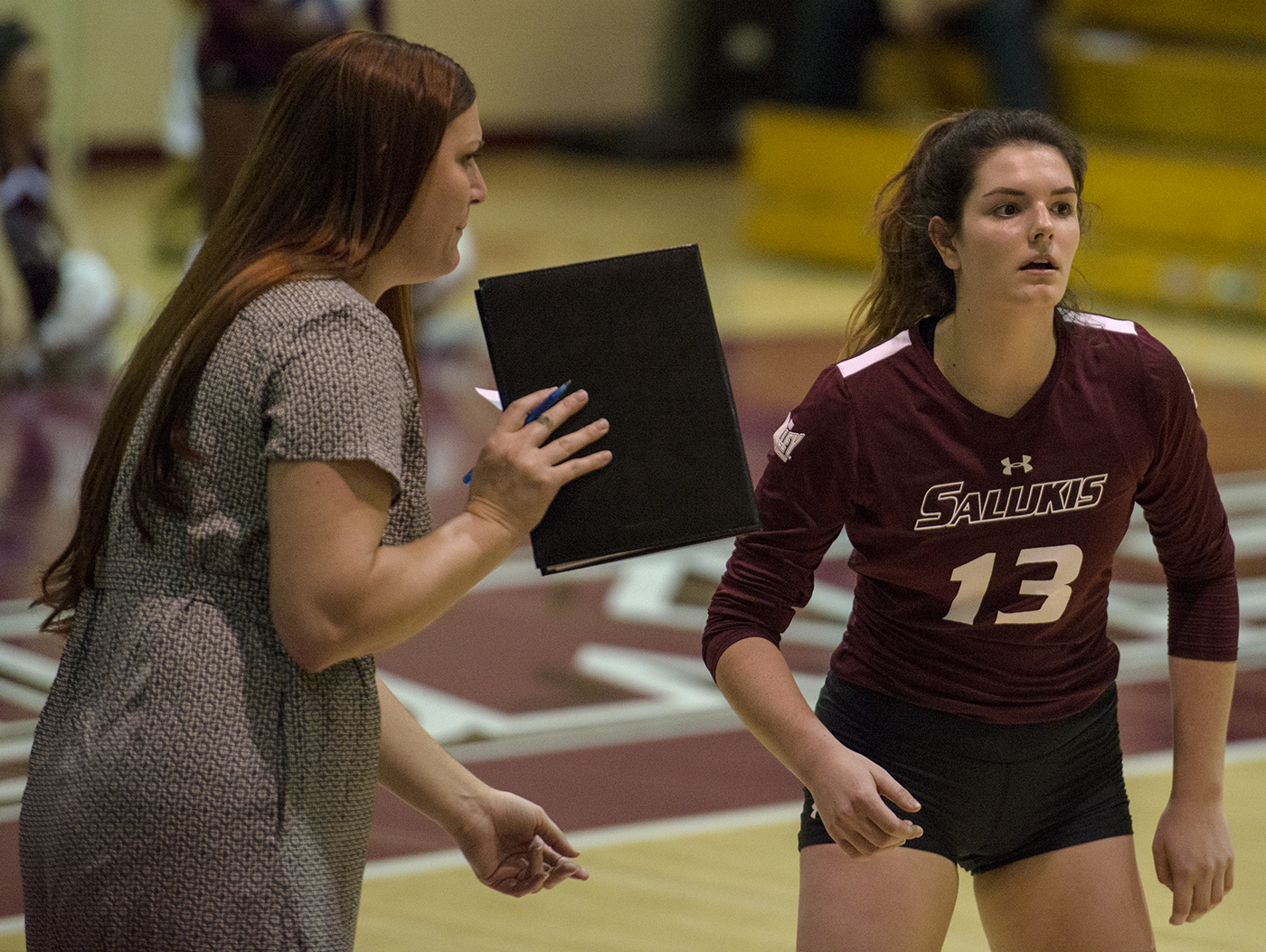 Coach Kari Thompson, (left), consults freshman setter Rachel Maguire Saturday, Oct. 20, 2017, during the Salukis' five set loss against Bradley University at Davies Gym. (Mary Newman | @MaryNewmanDE)