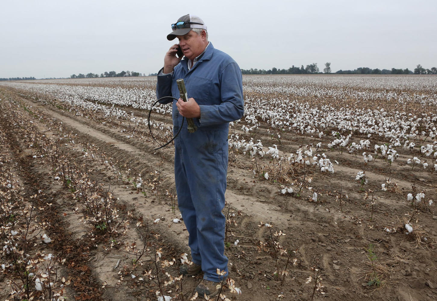 Farmer Jason Bean calls to locate a new belt for his cotton picker on Wednesday, Oct. 12, 2017, at his farm near Peach Orchard, Mo. Bean is busy harvesting his soybeans, rice, and cotton this month. The broken belt shut down his cotton picker for a short time until he got it replaced. The $49 belt is needed to keep the $800,000 cotton picker working. (J.B. Forbes/St. Louis Post-Dispatch/TNS)