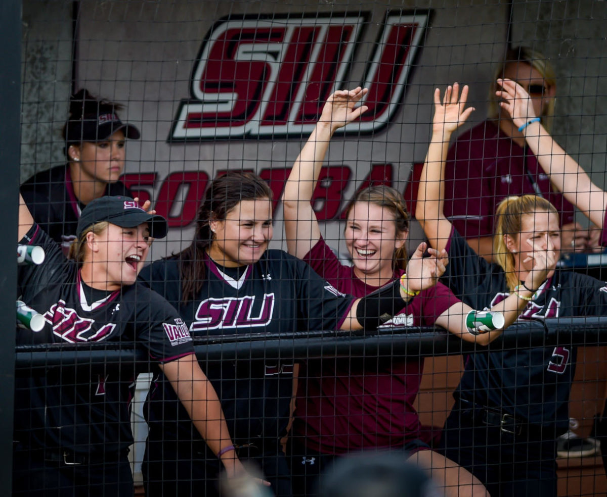 SIU Softball members celebrate a home run Sunday, Oct. 1, 2017, during the Salukis' 3-2 win against the University of Southern Indiana Eagles at Charlotte West Stadium. (Dylan Nelson | @Dylan_Nelson99)
