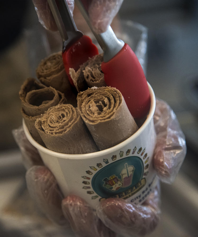 Thai ice cream rolls are placed into serving cup, Monday, Oct. 9, 2017, at Freeze in Carbondale. (Mary Newman | @MaryNewmanDE)