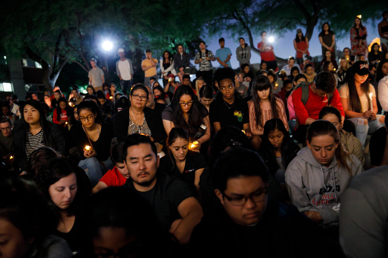 UNLV students hold a moment of silence for the victims of the mass shooting that killed 59 people and injured more than 525 on Oct. 2, 2017 in Las Vegas. (Marcus Yam/Los Angeles Times/TNS)