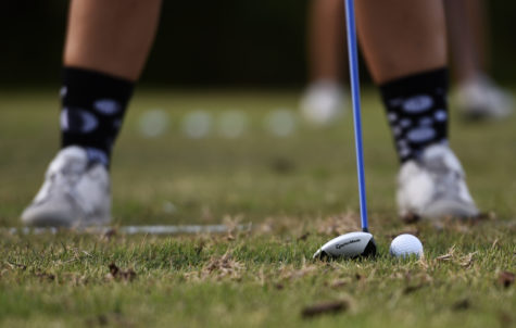 Freshman Rosemarie Bundy, of St. Charles, lines up for a pitch shot, Thursday, Oct. 5, 2017, at Hickory Ridge golf course. (Mary Newman | @MaryNewmanDE)