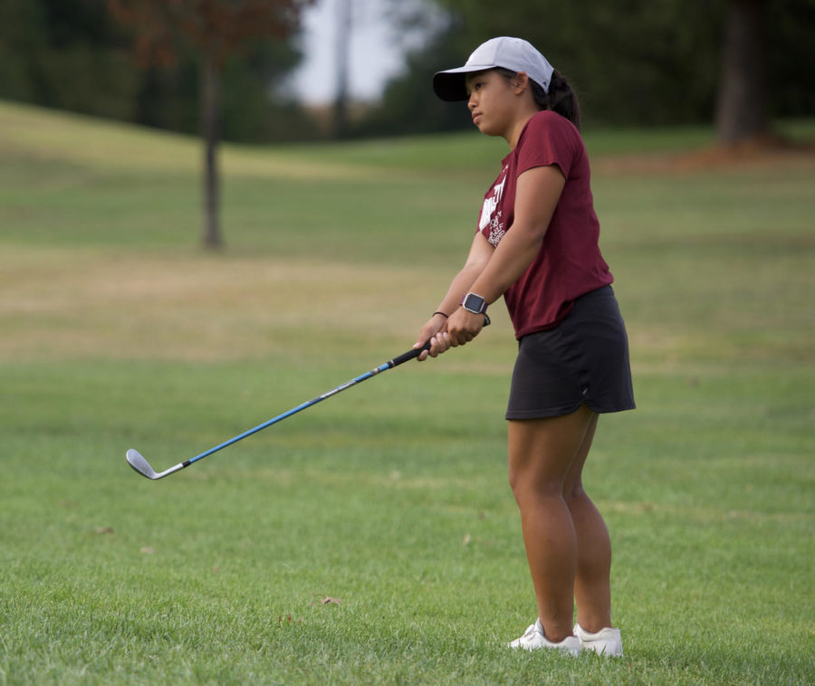 Senior Hanna Netisingha, of Carol Stream, makes a chip shot Thursday, Oct. 5, 2017, at Hickory Ridge golf course. (Mary Newman | @MaryNewmanDE)