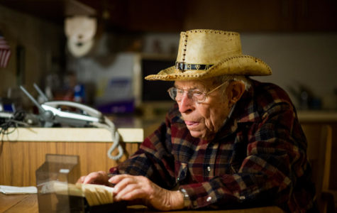 World War II veteran Calvin Maginel, of Anna, looks through a Rolodex Friday, Nov. 10, 2017, at his home in Anna. (Brian Muñoz | @BrianMMunoz)