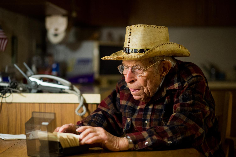 World War II veteran Calvin Maginel, of Anna, looks through a Rolodex Friday, Nov. 10, 2017, at his home in Anna. (Brian Muñoz | @BrianMMunoz)