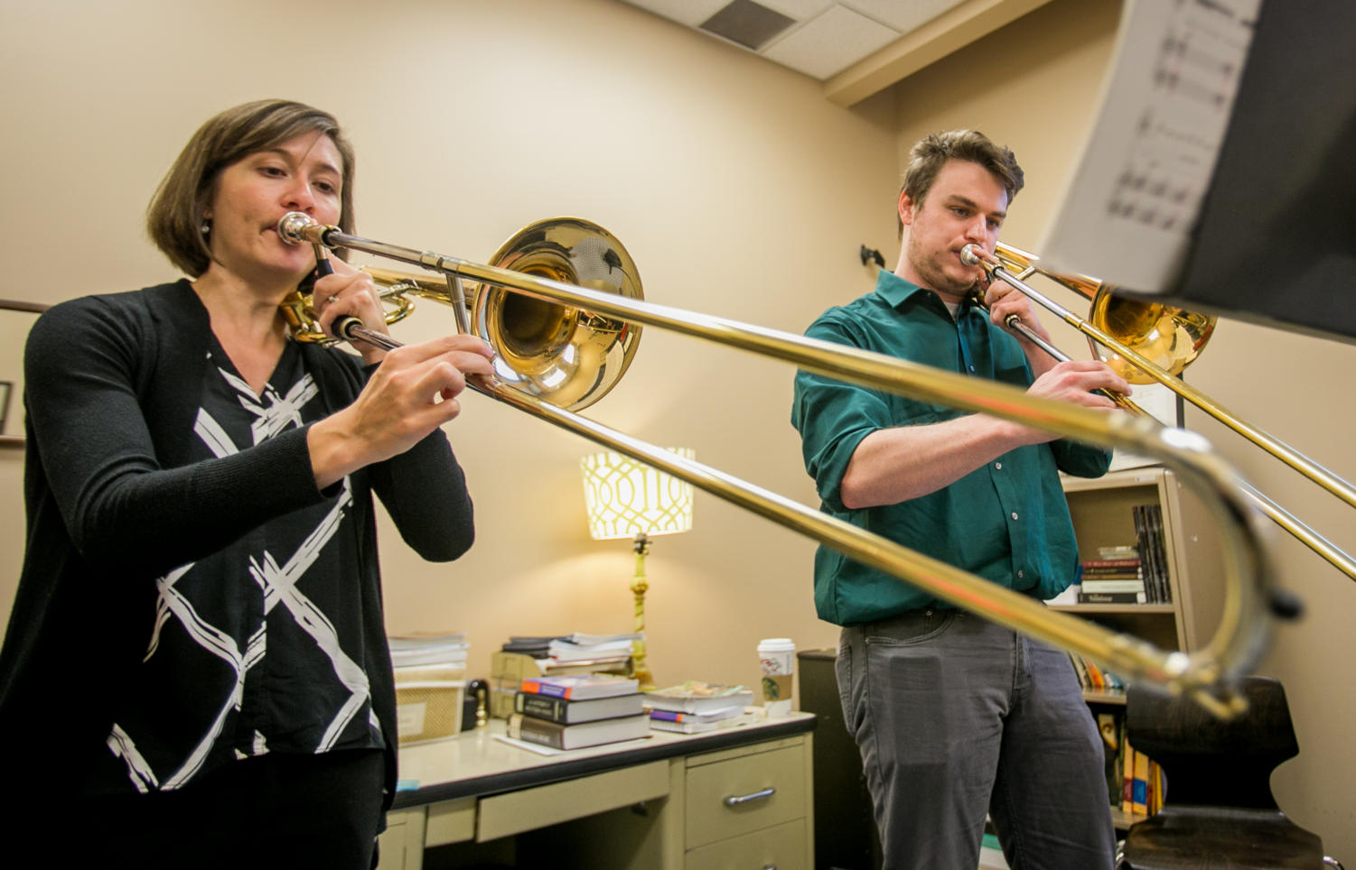 Low brass professor Jessica Butler, left, works with masters student Weston Mayer, of Shippensburg, Pennsylvania, in her office at Altgeld Hall. (Brian Muñoz | @BrianMMunoz)