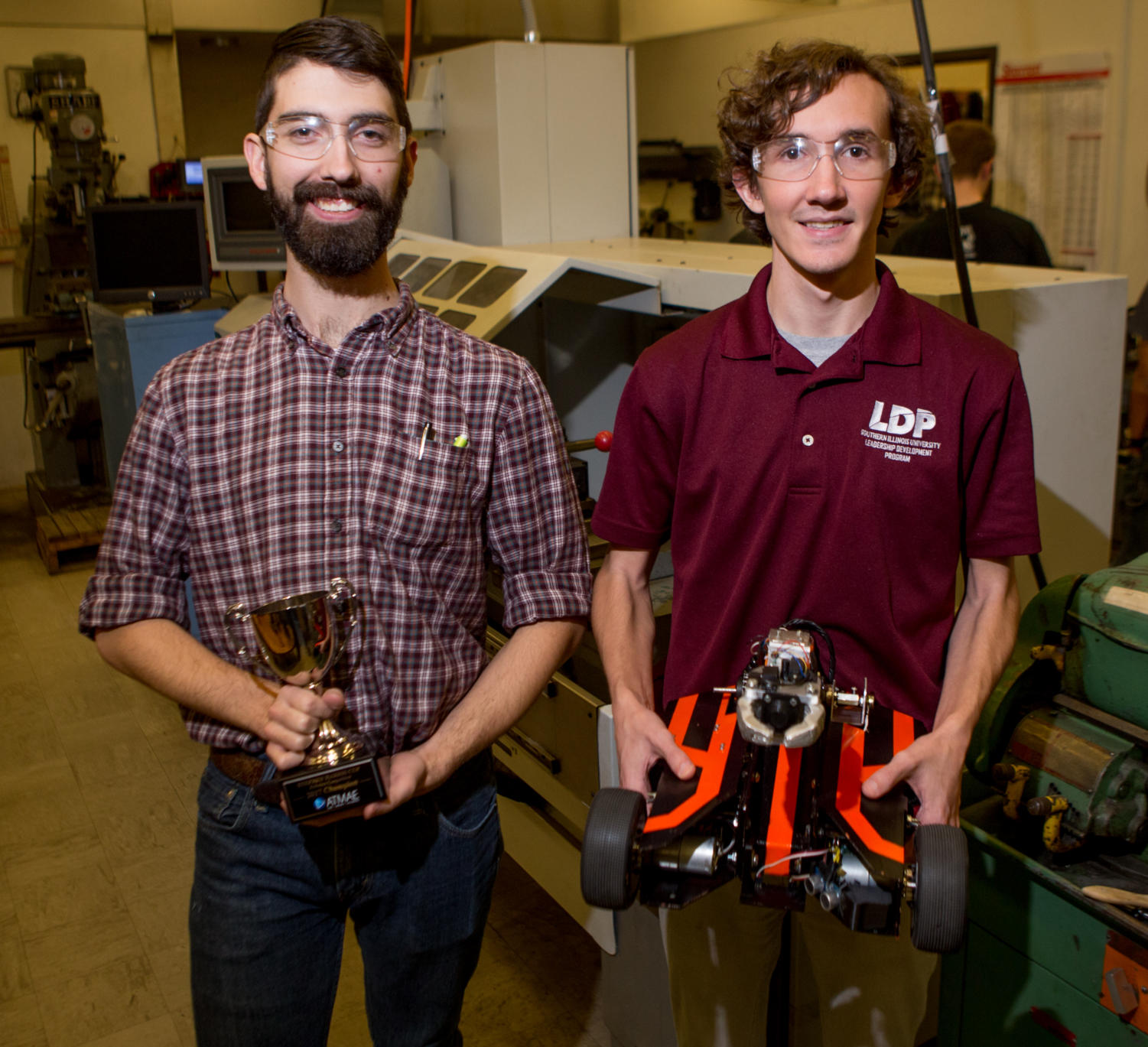 Nate Johnson, a junior studying electrical engineering from Abingdon, poses for a portrait alongside Lincoln Kinley, a junior studying electrical and computer engineering from Springfield, Wednesday, Nov. 16, 2017, in the industrial processes lab in the Engineering Building. The SIU Robotics team was the champion at the Association of Technology, Management, and Applied Engineering 2017 conference robotics competition with its robot,