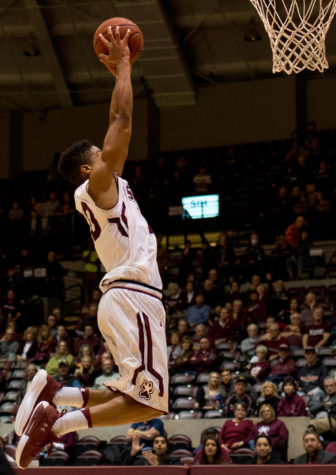 Sophomore guard Aaron Cook goes for a slam dunk Saturday, Nov. 18, 2017, during the Salukis
