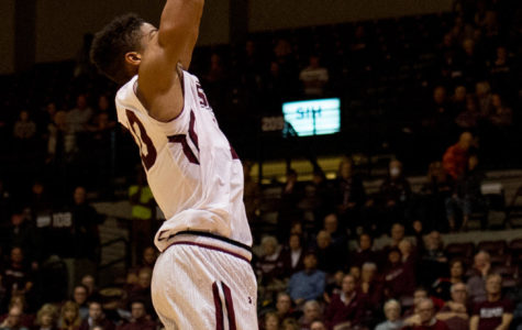 Sophomore guard Aaron Cook goes for a slam dunk Saturday, Nov. 18, 2017, during the Salukis' 69-64 win against the University of Illinois Springfield Prairie Stars at SIU Arena. (Brian Muñoz | @BrianMMunoz)