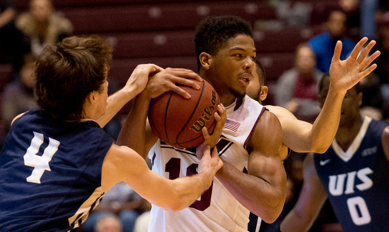 Sophomore guard Aaron Cook defends the ball Saturday, Nov. 18, 2017, during the Salukis' 69-64 win against the University of Illinois Springfield Prairie Stars at SIU Arena. (Brian Muñoz | @BrianMMunoz)